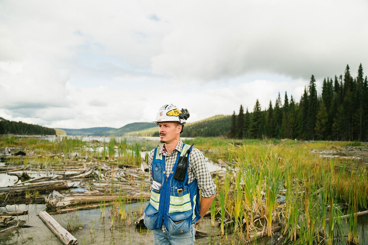environmental remediation contractor surveying affected lake.