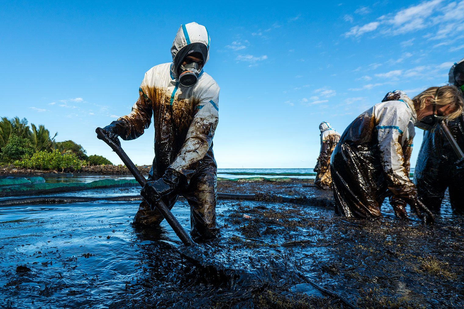 environmental remediation - oil spill cleanup crew offshore