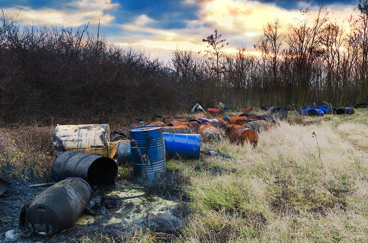 environmental remediation needed for toxic barrels dumped in open land.